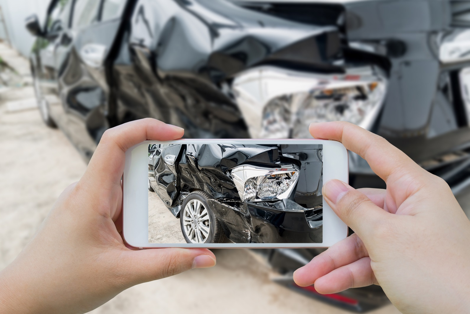Car crash accident damaged with hand using smartphone taking photo
